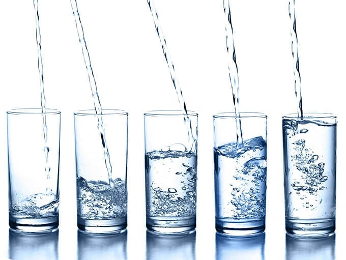 skincare row of water glasses
